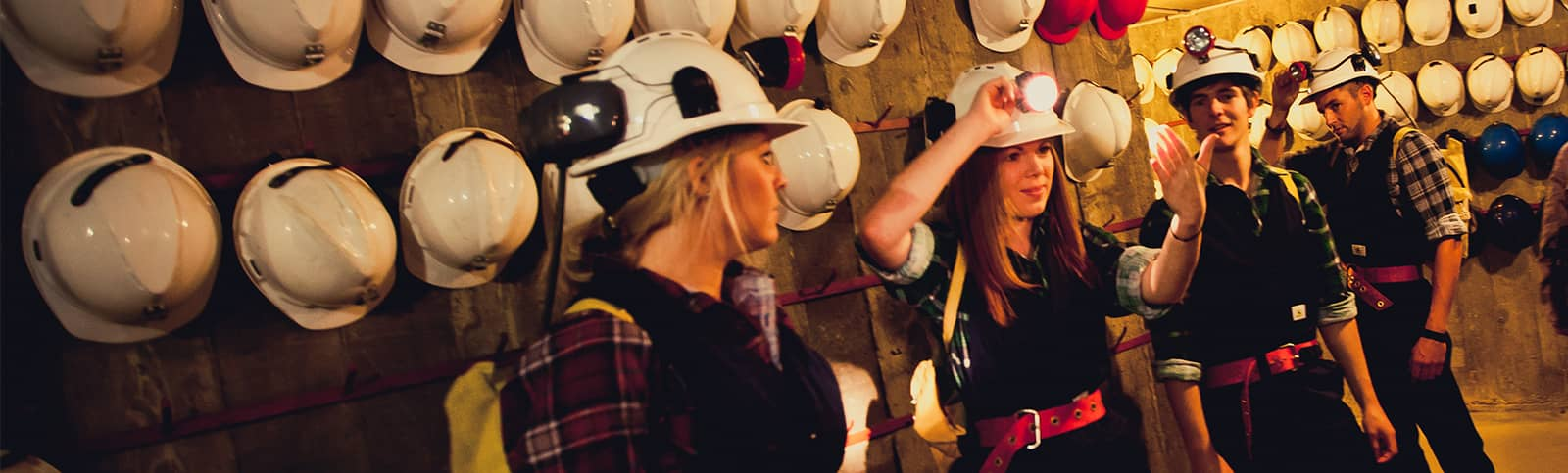 Putting helmets on for a Mine Experience Tour at Central Deborah Gold Mine