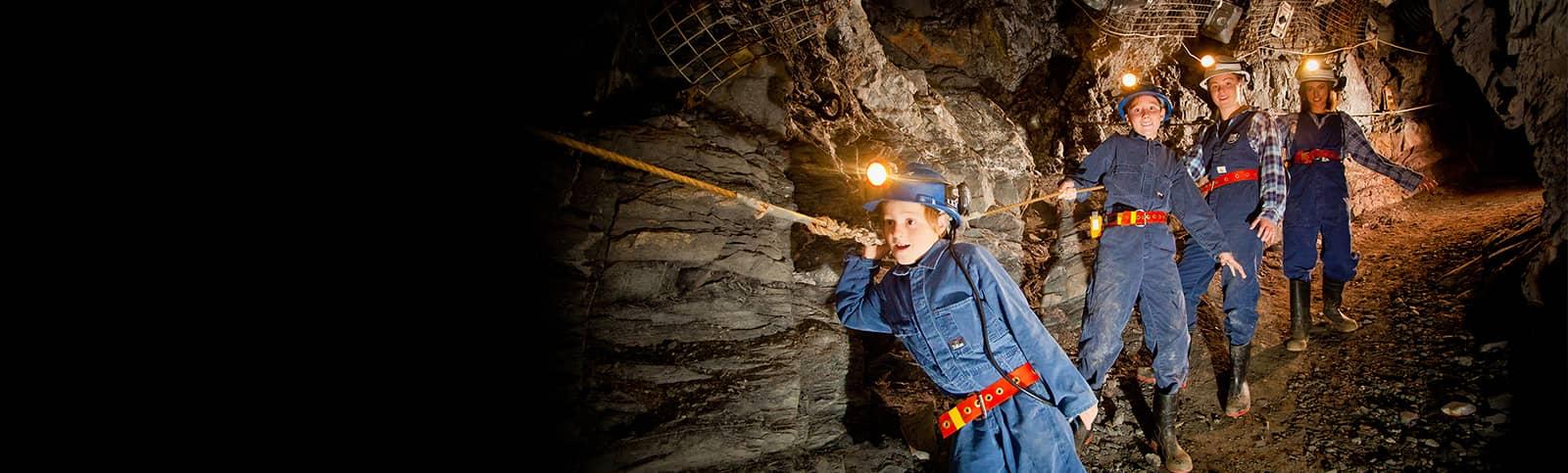 Visitors walking through underground tunnels on an Adventure Tour