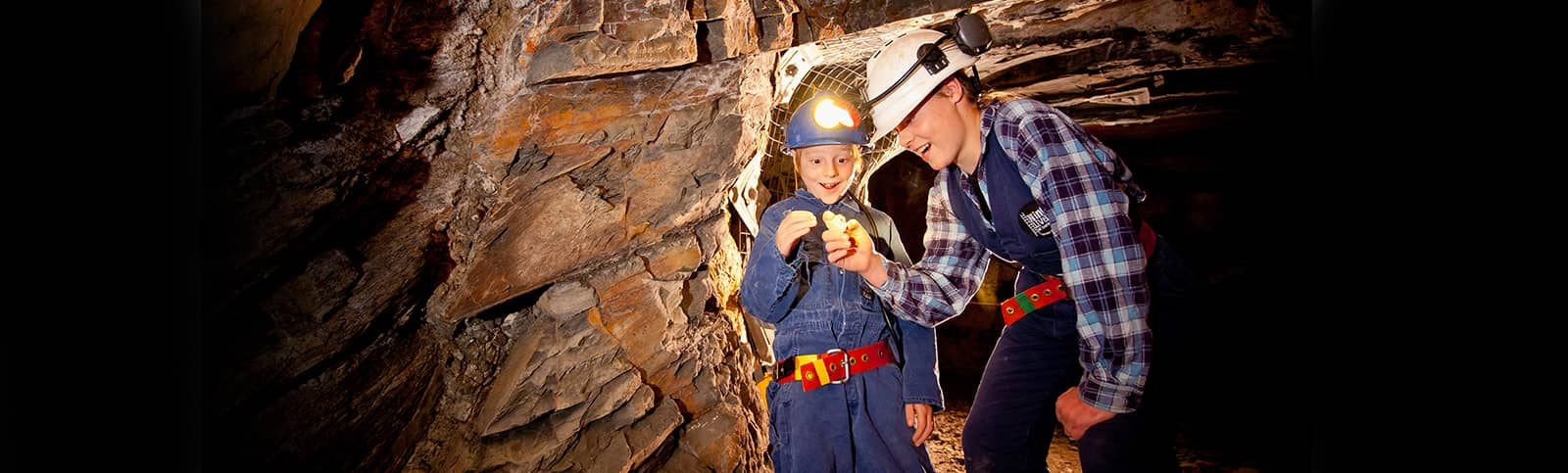 Visitors looking at a gold nugget 85 metres underground on an Adventure Tour